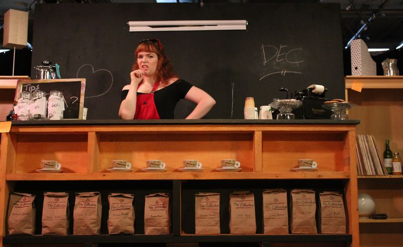 Confessions of a Redheaded Coffeeshop Girl playwright & performer: Rebecca Perry as Joanie Little. Photo Credit: Bryan Zilyuk